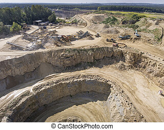 Mining quarry with special equipment, open pit excavation...