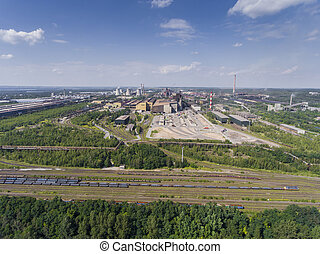 Steel factory with smokestacks at sunny day.Metallurgical...