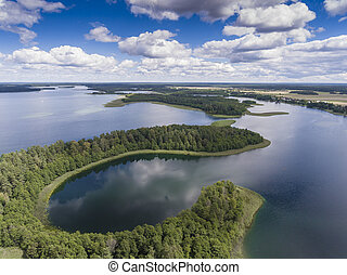 View of small islands on the lake in Masuria and Podlasie...