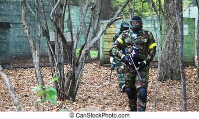 some players in paintball goes somewhere together on...