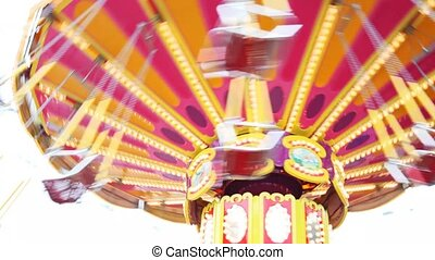 shone carousel fast turns in park close up in summer