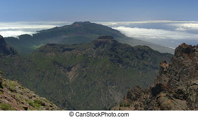 Time lapse fast clouds over volcano wall, La Palma, Canary...