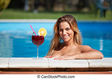 smiling woman in a swimming pool