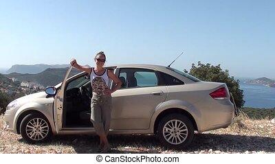 Woman leaving car open walks away