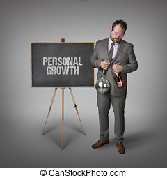 Personal growth text on blackboard with businessman