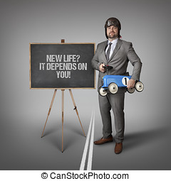New life it depends text on blackboard with businessman and...