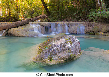 Deep tropical blue stream waterfalls in natural forest...