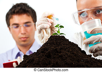 Biologists making an experiment in labor - Two young...