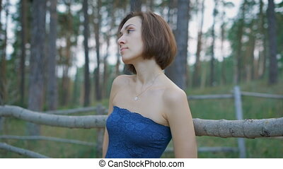Portrait of a beautiful girl in the woods or park. Woman...