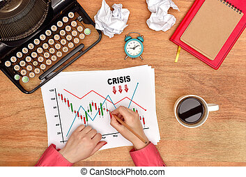 hands drawing crisis stock chart