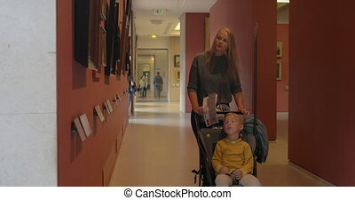 Mother and son visiting Louvre Museum - PARIS, FRANCE -...