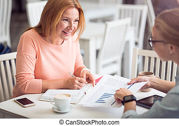 Cheerful woman conducting an interview
