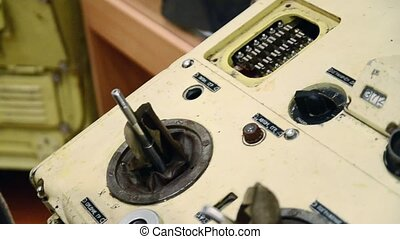 Hand push lever arm of ship management console of submarine...