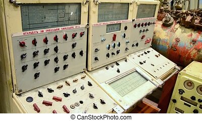 View of ship management console of submarine in fleet museum. Selectors. Details