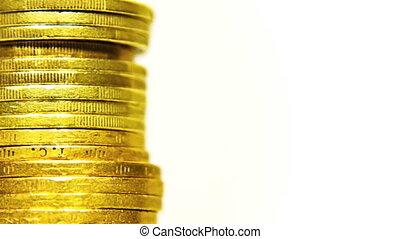 Macro shot rotating stack of coins