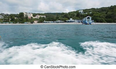 view on health resort in sea shore from going boat