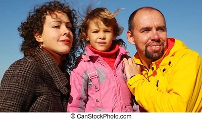 portrait of mum, daddy and daughter together against clear...