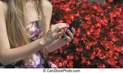 Young girl with smartphone outdoors