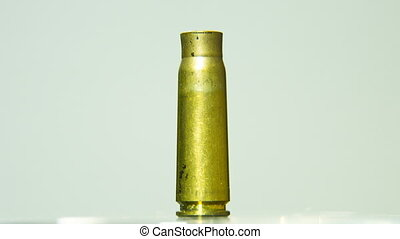 Empty Bullet Shell Rotating on a solid Background