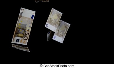 Paper Euro currency falling, black background
