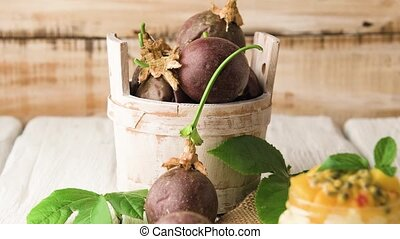 Passion fruits s on a wooden bucket