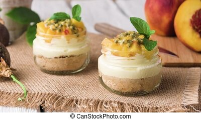 Desert with yogurt and passion fruit top on wooden table.