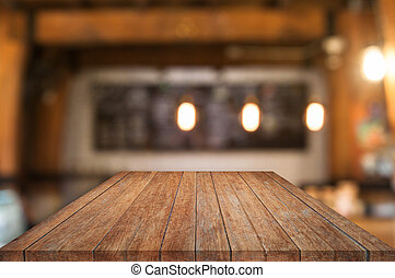 Perspective wooden table top with coffee shop blurred...