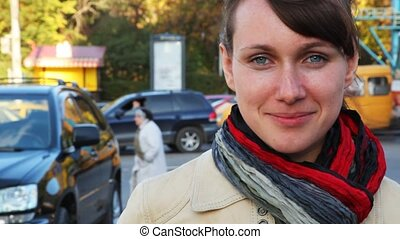 portrait of smiling woman in street cities in front of going...
