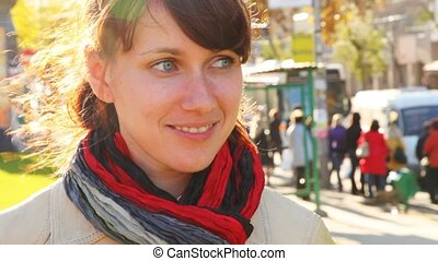 portrait of smiling woman close up in street cities in front...