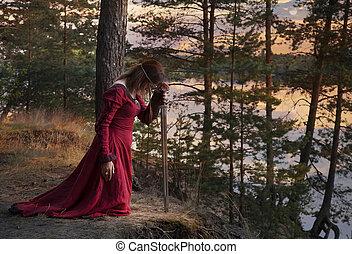 orando, mulher, jovem, espada
