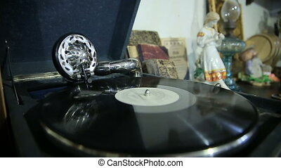 Old gramophone playing vinyl record - Old gramophone playing...