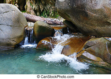 Small wonderful refreshing waterfalls among rocks