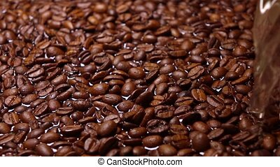 Pouring water on roasted coffee beans, super slow motion shot