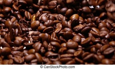 Throwing roasted coffee beans on pan, super slow motion shot