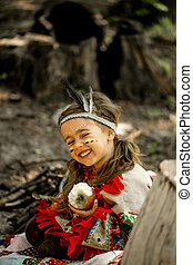 beautiful little girl playing on the nature of the Indians -...