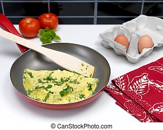 Omelette - A freshley cooked herb omelette in a frying pan