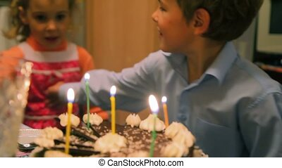 boy and girl with birthday cake