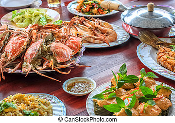 Thai style set of seafood insist of Thai steamed curry fish...