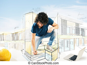 Drawing a house project - Man draws and designs the...