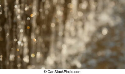 Sparkling water surface bokeh, flowing river water out of...