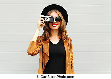 Fashion look, pretty cool young woman model with retro film...