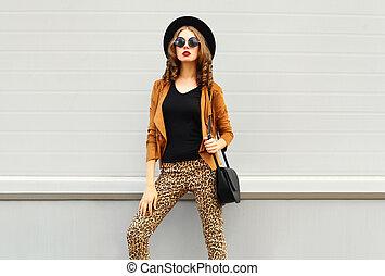 Fashion look, pretty woman wearing a retro elegant hat,...
