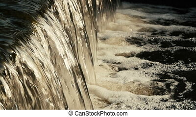 Flowing river water close-up - Peaceful flowing water in the...