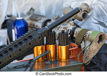 ammunition to arms closeup - military equipment and...