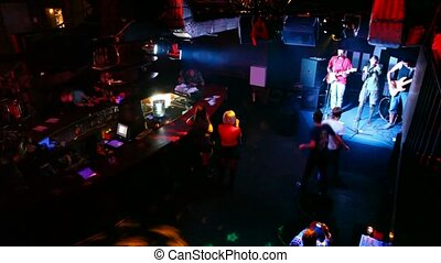 musical group live on stage in club