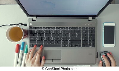 Female hands working on laptop on graphic design - Female...