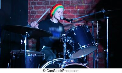drummer playing on dums live on stage