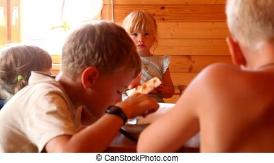 kids eating at the wooden table