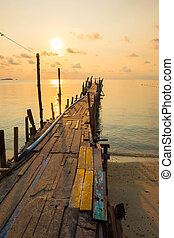 Jetty bridge made from wood during sunrise in dawn