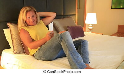 Woman relaxing with television